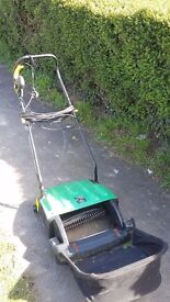 Lawn scarifier electric