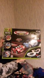 Night challenge raceway with light up cars
