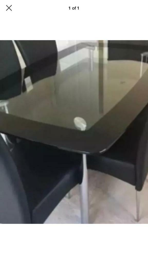 Glass Table With Black Shelf Underneath In Shepperton Surrey