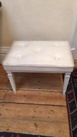 White dressing table or piano stool.
