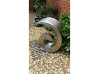 """Ammonite brushed stainless steel water feature- Height 26""""/66cm, base 8""""/20cm wide, spout 13.5""""/35cm"""