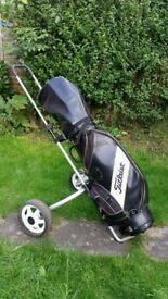 Golf clubs (irons from King Cobra, Mizuno, Wilson) in a bag with trolley & ball retriever