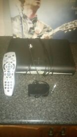 Sky+ HD box with wireless connecror and remote.