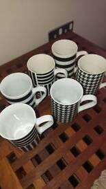 5 black and white stripped mugs