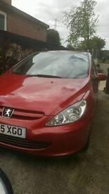Peugeot 307, 3 door, red.