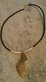 Interesting polished stone necklace