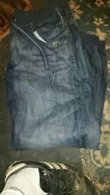 Ladies dark blue elastic bottoms+ button/string fastening denim jeans +