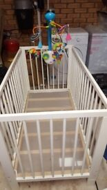 Cot with tiny love mobile