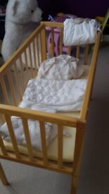 Light wood baby crib.