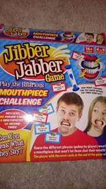 Jibber jabber family game. New with 10 mouthpieces