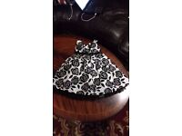 Pretty child's dress, oyster silky background with raised black flock roses to fit age 6 years