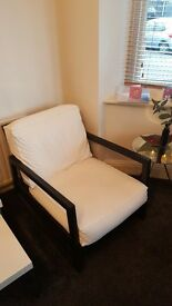 Black wooden arm chair, with white cushions