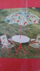 Kids patio set. Table with umbrella, 2 chairs. See photos.