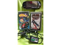 PSP with 2 games and charger