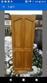Arched top pine door.
