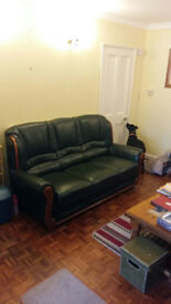 EXCELLENT CONDITION GREEN LEATHER SOFA AND ARM CHAIR