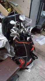 Selection of golf clubs and bag