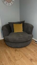 DFS snuggle swivel chair/sofa