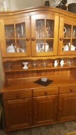 Pine dresser triple cupboards good condition . Buyer to collect