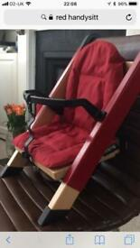 Red Handysitt high chair with bag and rear legs adaptor