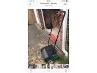 Garden equipment, qualcast lawn rake and scarifier.