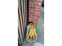 long hose pipe on green reel