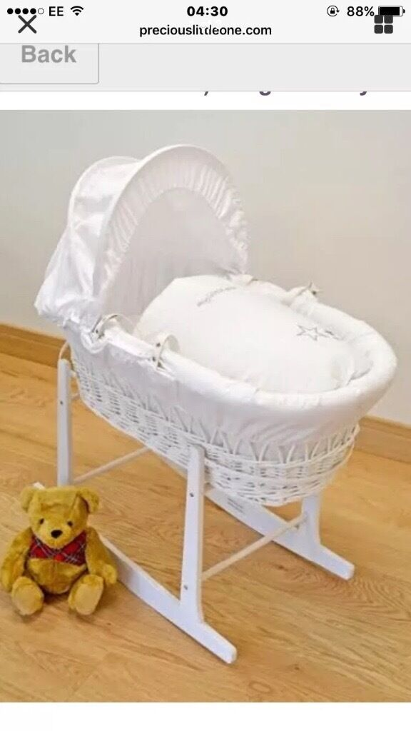 White wicker moses basket with pine stand
