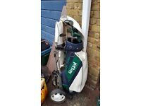 half set of left handed golf club with bag and trolley