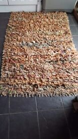Large rag rug.old hand made rug.brown tones mainly.good condition