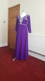 Long flowy purple dress with silver bodice design, fully lined.