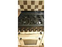 FOR SALE: Immaculet Rangemaster 110 duel fuel range cooker in cream and brass