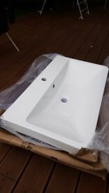 Large white sink unit with chip