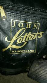 John letters golf clubs and bag