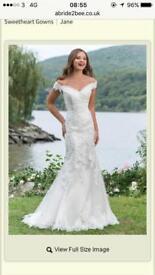 Justin Alexander 6155 off shoulder wedding dress