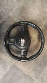Seat steeringwheel and airbag