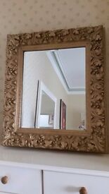antique heavily carved gold mirror