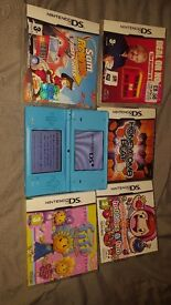 Nintendo dsi with 5 games