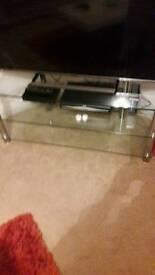 Glass corner tv unit and console table.