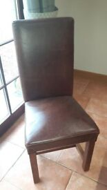 Brown leather dining chairs with solid oak legs