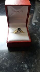 9ct. Gold diamond and sapphire ring