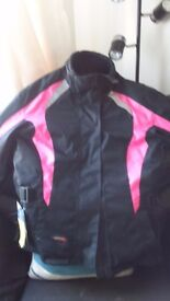 MOTORCYCLE JACKET LADY'S MEDIUM. NEVER WORN NEW WITH TAGS. BLACK/PINK