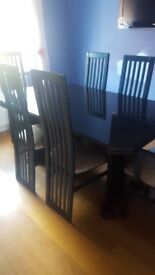 Dark navy dining table with 6 matching chairs and matching corner display cabinet