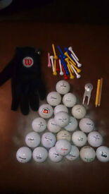Golf clubs and a fazer puter and balls and tees and golf bag