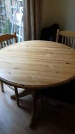 Pine dining room table with 4 chairs