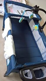 Large travel cot with accessories