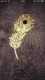 Old sparkly gold coloured peacock feather broach