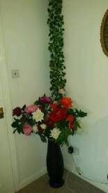 Reduced price flowers with a pot