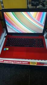 Red Asus laptop