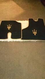 Maserati car mats, brand new. .