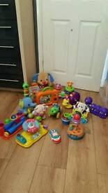 assortment of musical baby toys